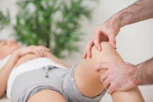physio treating a meniscus tear